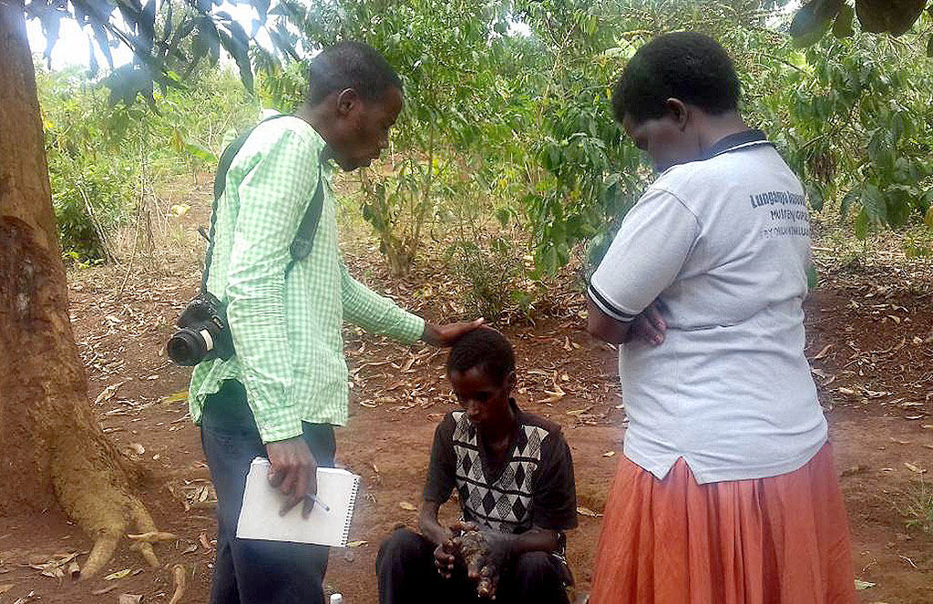 Luyinda being prayed for by a team from Kitovu Mobile